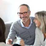 couple discuss real estate with agent